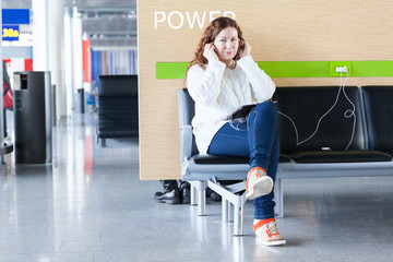 Woman listen music in place to charge you phone