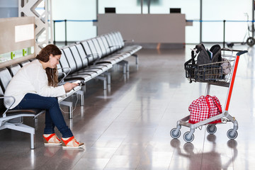 Spending time in airport lounge with luggage hand-cart