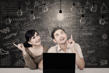 Couple looking at solution light bulbs in class
