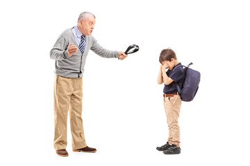 Angry grandfather holding a belt and shouting at his nephew