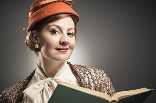 Retro Styled Woman Reading A Book
