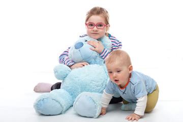 Little girl with big blue teddy bear