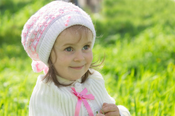 Smiling cute baby girl with hat