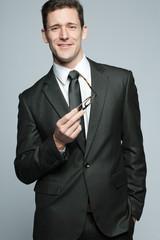 Handsome businessman in black suit.