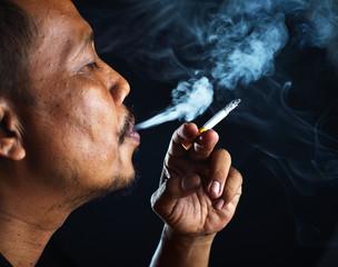 Close up man smoking