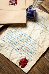 Old letter sealed with red sealant and written in blue ink