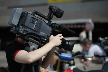 Video camera operator working with his professional equipment