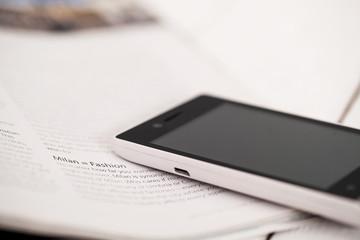 Smartphone on a magazine corner