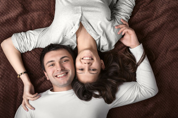 loving couple lying on the bed