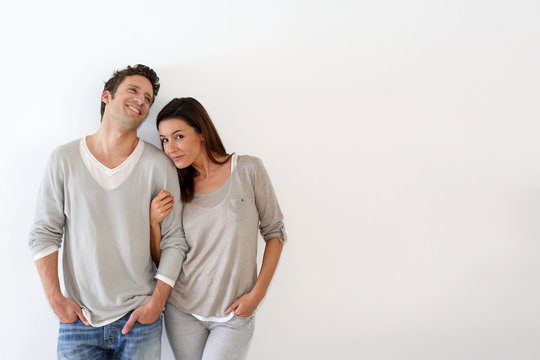 Young couple standing on white background