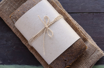 Fresh rye bread on wooden background