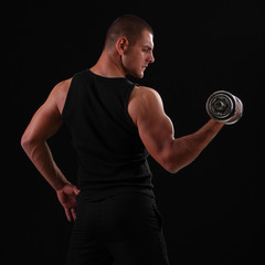 strong man with dumbbells in his hands