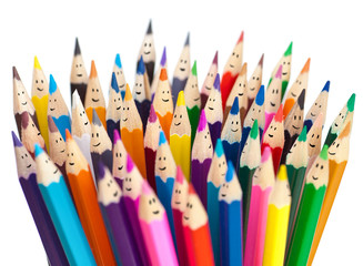 Fototapeta Colorful pencils as smiling faces people isolated. Social networ obraz