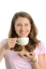 Junge,bruenette Frau geniesst eine Tasse Kaffee.