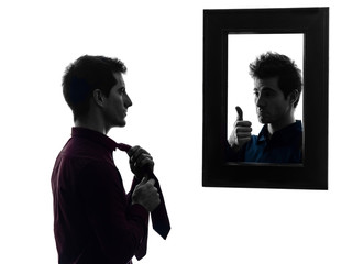 man in front of his mirror dressing up silhouette