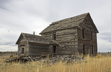 Close up abandoned wooden home ruins in Oregon