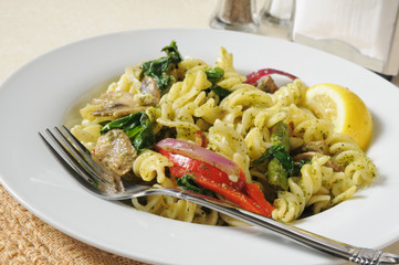 Pasta salad with spinich and basil