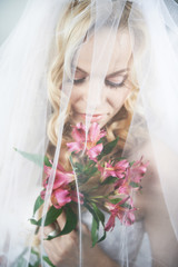 Beautiful bride with bouquet of lilies