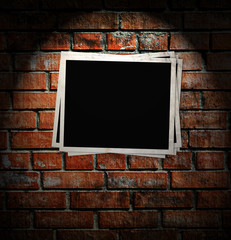 Photo frame on the brick wall