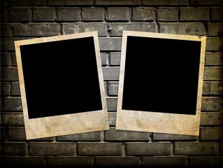 Photo frames on the brick wall