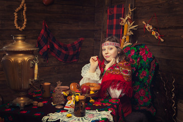 Russian beauty before Christmas in a wooden interior