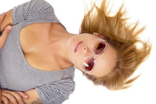 Young beautiful woman lying in sunglasses
