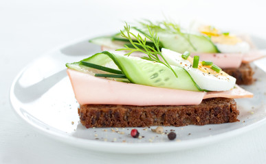 Sandwiches with egg, ham, cucumber and chives