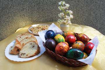 Colorful eggs and festive cake for Easter
