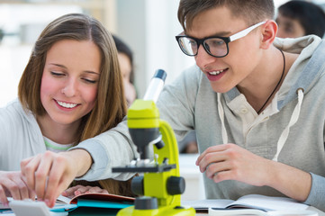 High School students. Girl and boy working together at biology c