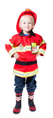 A happy four-year boy in the costume of fireman