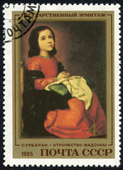 stamp printed in the USSR showing portrait of Madonna