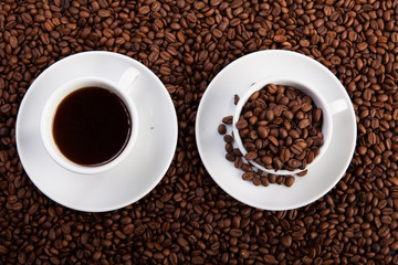 cup of coffee and cup with coffee beans