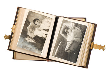 open antique album with baby photos
