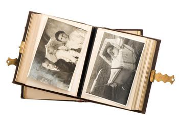 open antique album with baby photos