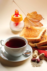 Slice toast bread and cup of tea