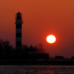 lighthouse silhouette at the sunset