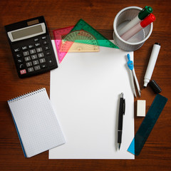 Desk with sheet of paper and stationery objects