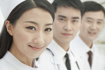 Healthcare workers standing in a row, China, Close-up
