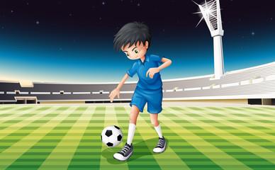 A soccer player in a blue uniform