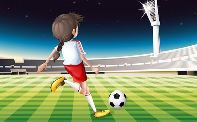 A girl playing soccer at the field