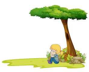 A girl sitting under the big tree