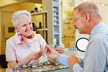 Customer looking for glasses at optician