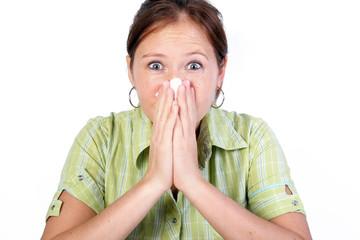 women blowing nose
