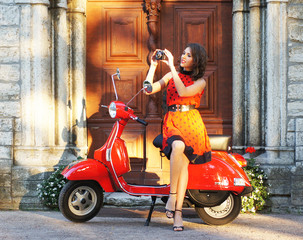 Vintage image of young attractive girl and old scooter