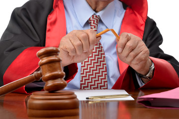 Senior judge breaking pencil which means death penalty