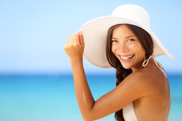 Wall Mural - Vacation beach woman smiling happy portrait