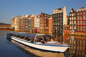 Fotobehang Amsterdam Amsterdam with tourist motor boat in Holland