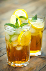 Two glasses with iced tea and lemon