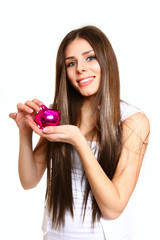 Young woman with a piggy bank on a white background close-up