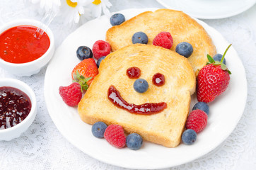 Breakfast with a smiling toast, fresh berries, jams